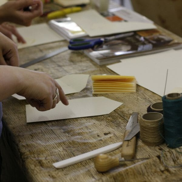 Bind Your Own Art Journal bookbinding workshop Leeds. Participants will bind their own pages and will learn how to incorporate them into a book,