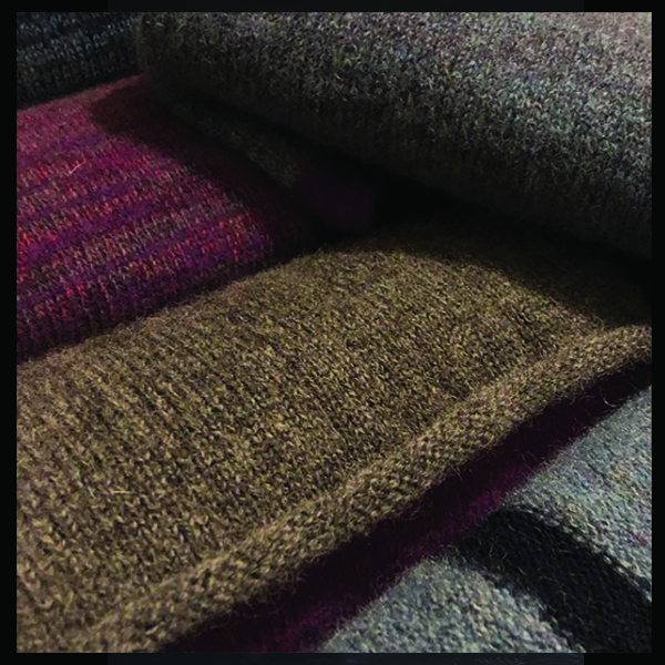 Leeds based Independent Knitwear designer Specializing in luxurious knitted garment and accessories including sweaters, scarves and gloves for men