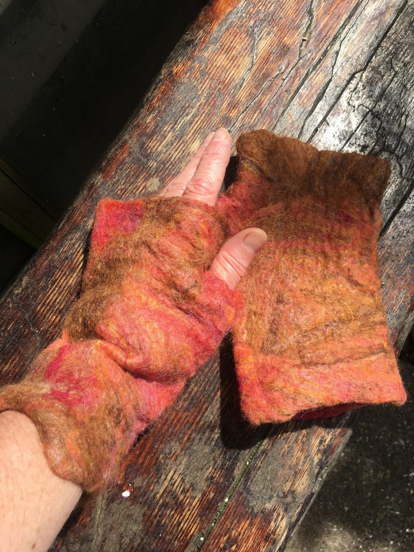 A pair of felted gloves