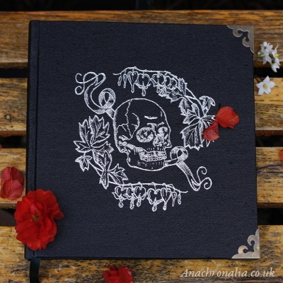 Black book with silver skull decoration
