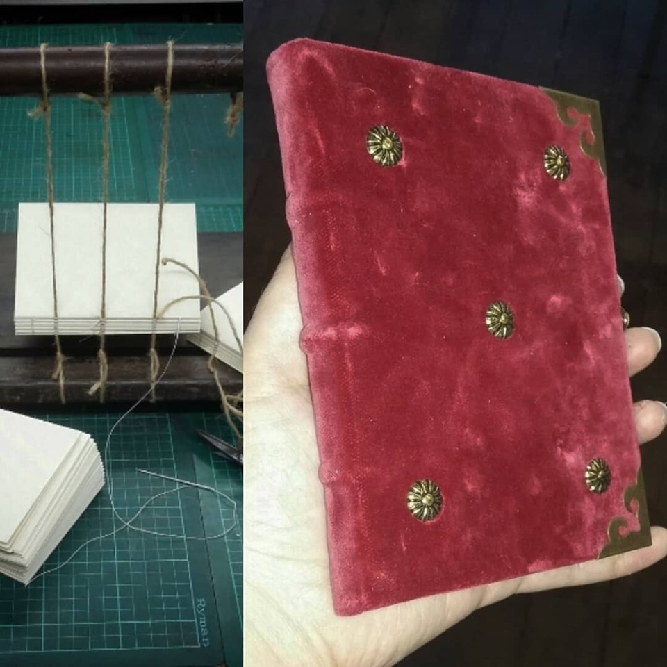 A bookbinding sewing frame and a velvet covered book